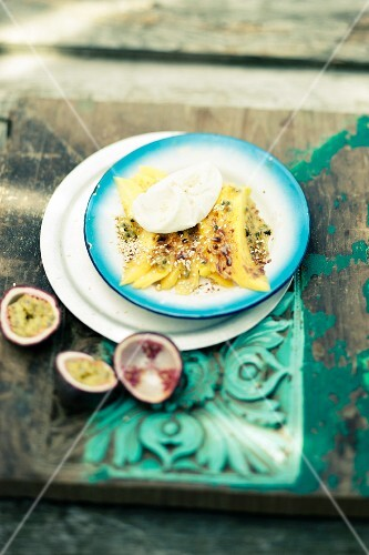 Mango gratin with coconut ice cream and passion fruit