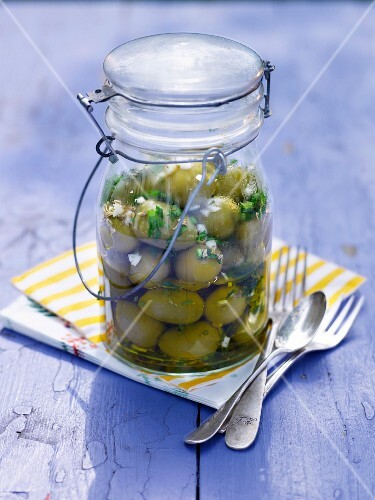 Marinated olives in a preserving jar