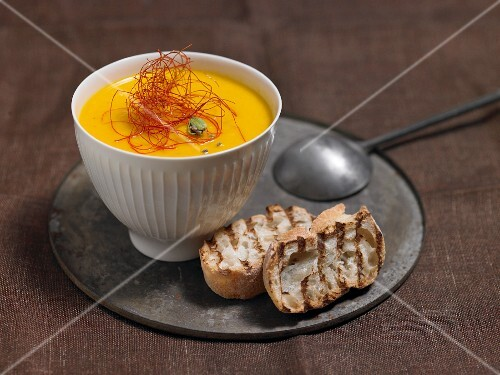 Carrot and orange soup with grilled bread