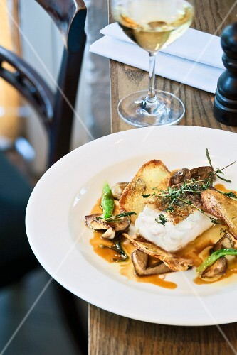 Fried Iceland cod with mushrooms, potatoes and veal jus