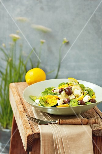 Millet salad with spinach, sheep's cheese and olives