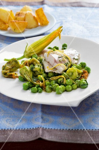 Fish fillets with pumpkin flowers and young peas