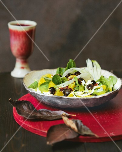 Lamb's lettuce with fennel, oranges, sheep's cheese and olives