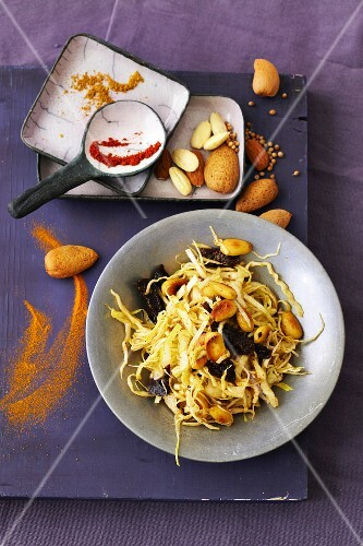 Cabbage salad with spices, dried plums and roasted almonds