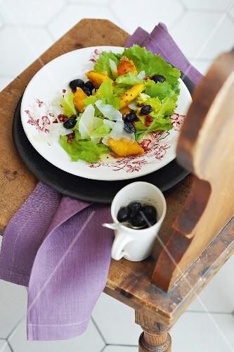 Endive salad with polenta, bacon, olives and Parmesan