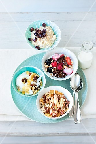 Four different types of muesli in bowls