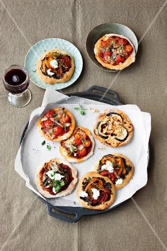 Various mini vegetarian pizzas