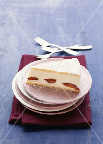 A slice of creamy cheesecake with plums