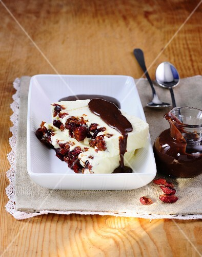 Coconut parfait with cranberries and ginger and chocolate sauce