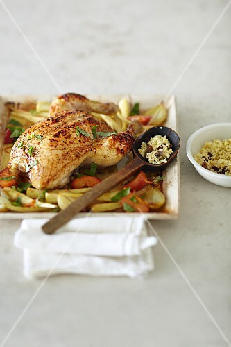 Grilled honey chicken on a bed of vegetables with peaches