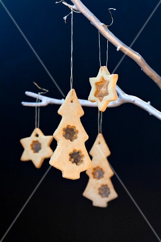 Christmas biscuits decorated with bonbons as tree decorations