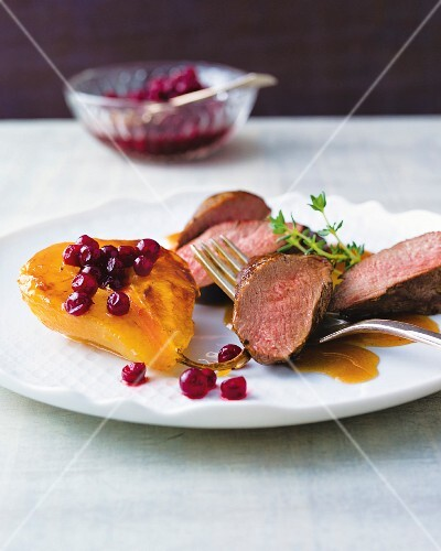 Saddle of venison with caramelised pears