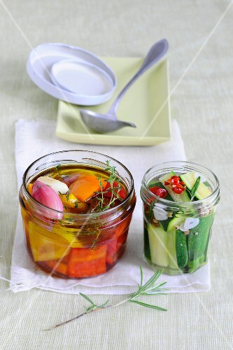 Spicy preserved peppers and courgette in jars