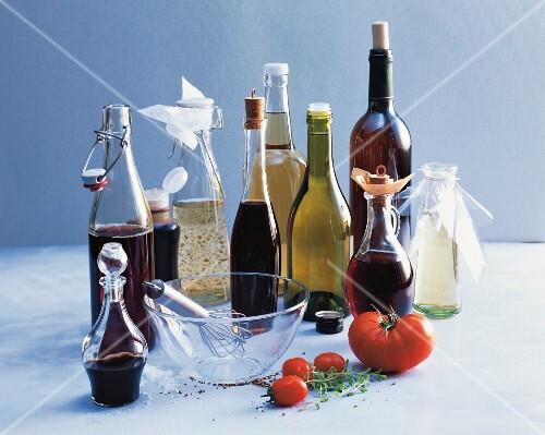 An arrangement of various types of vinegar in bottles