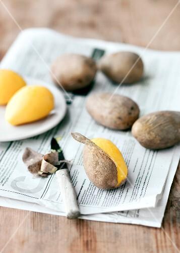 Potatoes being peeled