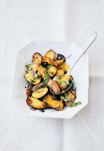 Fried potatoes with coriander grremolata