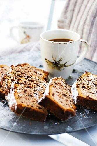 Loaf cake, sliced, and a mug of coffee
