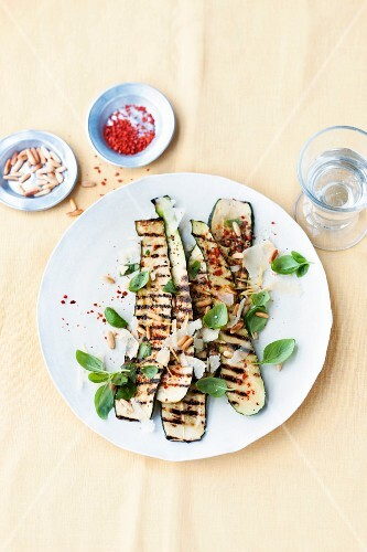 Grilled courgette with pine nuts and basil