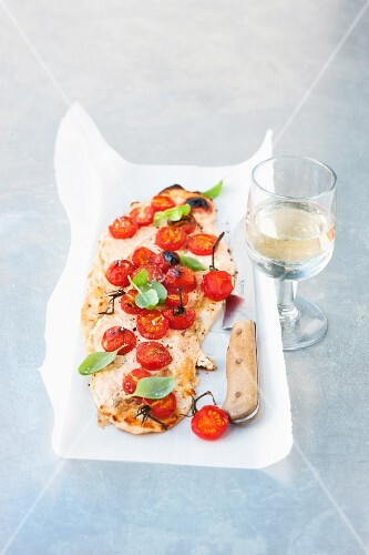 Tarte flambé with cherry tomatoes