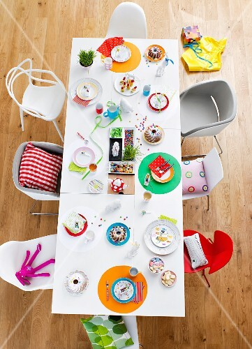 A dining table laid for a child's birthday party