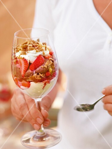 A desert with lemon mousse, chocolate cream, strawberries and amaretti