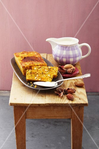 Baked carrot pudding with nuts and a marzipan source