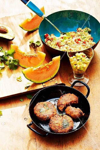 Bean burgers, millet salad and avocado salsa with melon (Mexico)