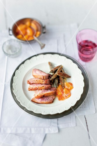 Duck breast with poppyseed pasta and hot stewed yellow plums