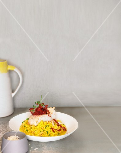 Loach fillet with chorizo on an almond and saffron risotto