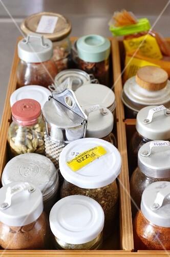 Storage jars in a drawer in a student kitchen