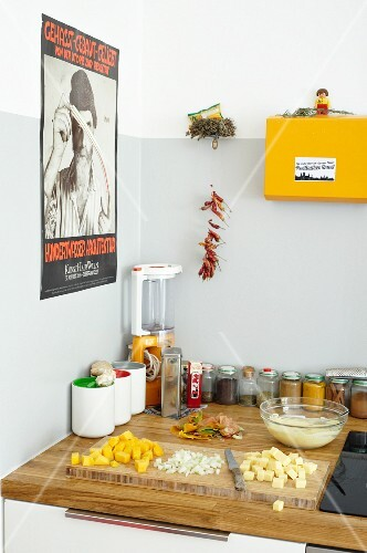 Ingredients for cheese and mango salad on kitchen worksurface in students' kitchen