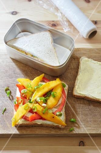 Tramezzini with mango, pepper and mozzarella