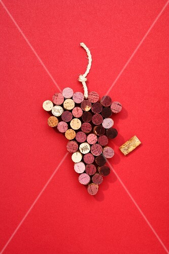 Wine bottle corks arranged in the shape of a bunch of grapes