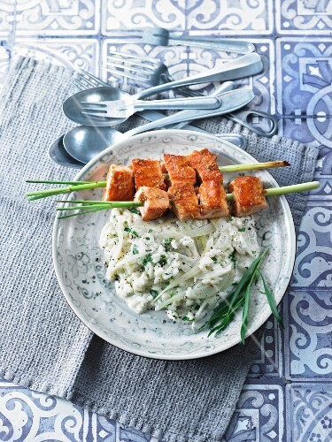 Lemongrass and salmon skewers on a bed of fennel risotto