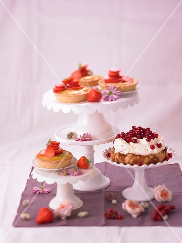 Almond tartlets with lemon curd and strawberries, and a marzipan tart with redcurrants