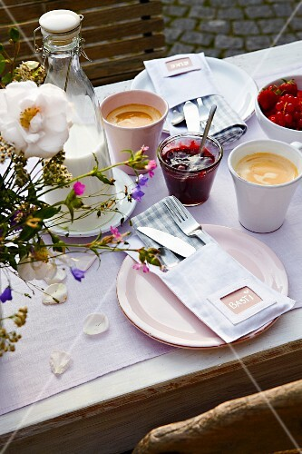 A table laid for breakfast outside