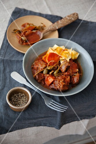 Braised lamb with capers, sweet potatoes and tagliatelle