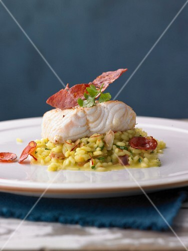Loach fillet with almond and saffron risotto and chorizo