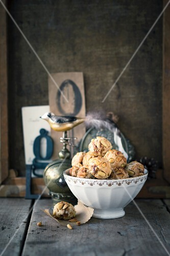 Fig and pine nut balls in a white porcelain bowl
