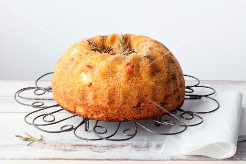 A sweet wreath cake with feta cheese, dried tomatoes and raisins