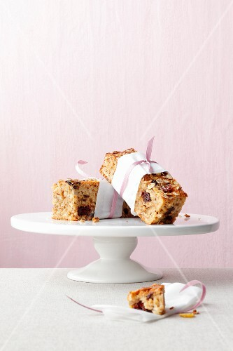 Pieces of fruit muesli cake on a cake stand