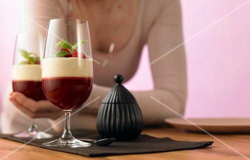 Raspberry jelly with verbena vanilla sauce in dessert glasses