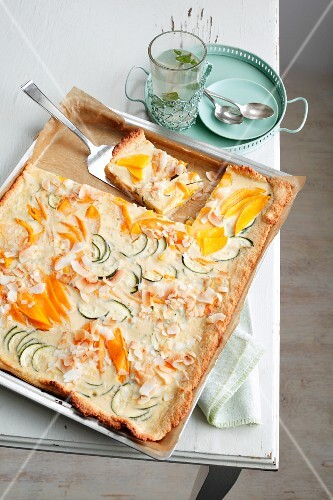 Mango tray bake with courgettes and a coconut topping