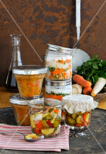 Spicy courgettes, tomato chutney and soup seasonings in jars