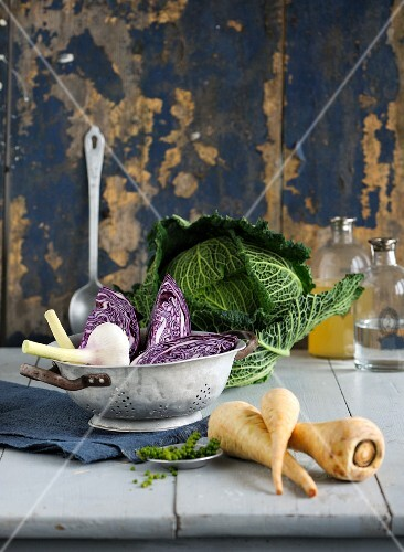 An arrangement of winter vegetables: red cabbage, savoy cabbage and parsnips