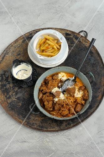Wild boar goulash and potato orzo pasta