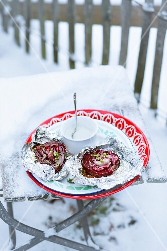 Beetroot with wasabi cream on aluminium foil in the snow