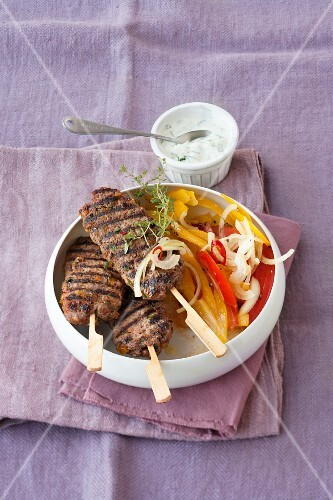 Minced lamb kebabs with a yoghurt sauce