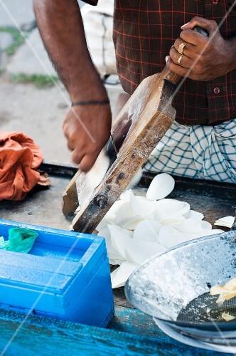 An Indian street vendor preparing potato chips
