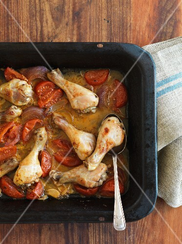 Chicken legs with tomatoes and onions